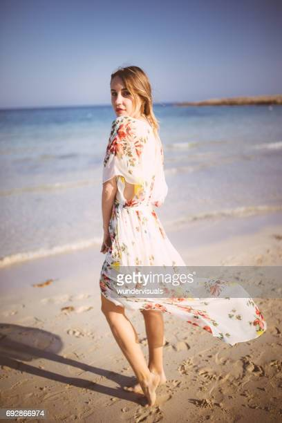 attractive young woman enjoying the sun at the beach - japanese bikini models stock pictures, royalty-free photos & images
