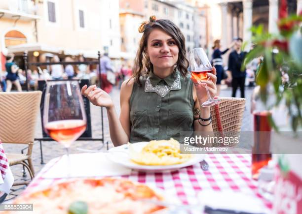 Attractive young woman having meal in Rome