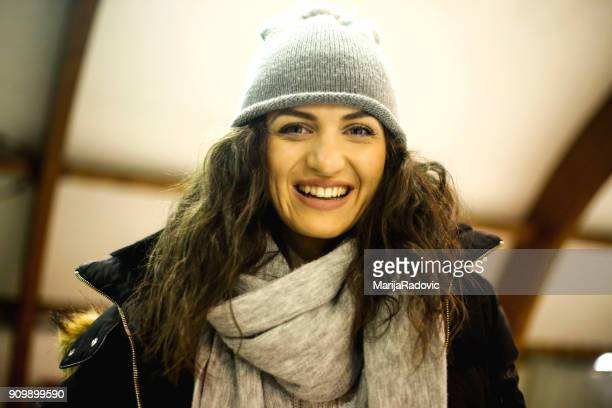 Attractive young woman ice skating during winter