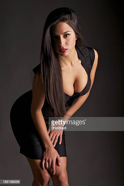 attractive young woman in a tight dress - bending over stock pictures, royalty-free photos & images