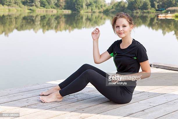 Attractive young woman near pond