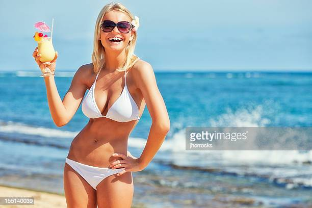 attractive young woman on beach with tropical refreshment - usa stock pictures, royalty-free photos & images