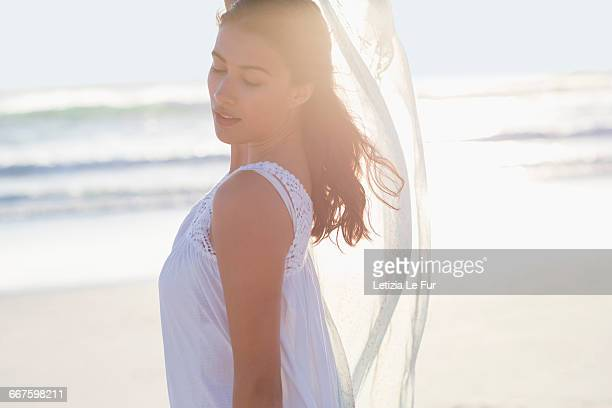 attractive young woman posing on the beach - sarong stock photos and pictures