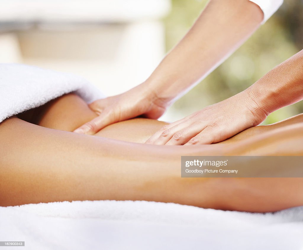 Attractive young woman receiving massage at dayspa : Stock Photo
