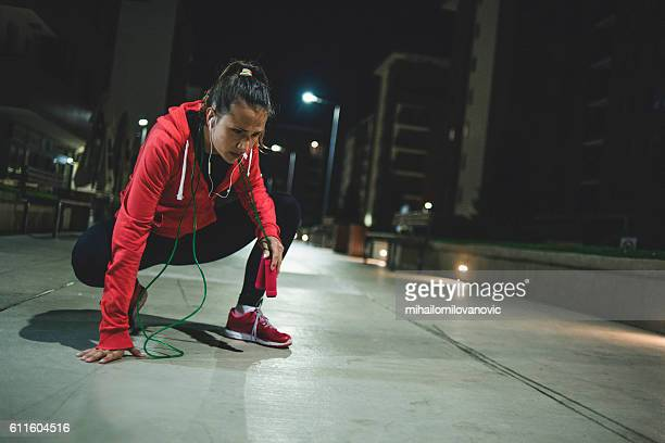 Attractive young woman resting after jumping rope