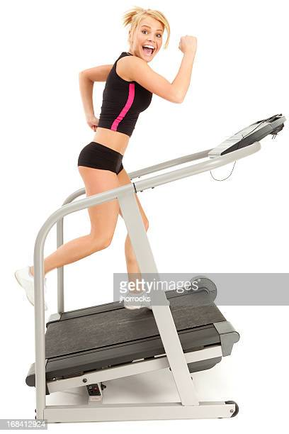 Attractive Young Woman Running Happily on Treadmill