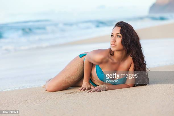 attractive young woman sunbathing on hawaiian beach - hot glamour models stock pictures, royalty-free photos & images