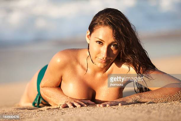 attractive young woman sunbathing on hawaiian beach - gorgeous babes stock photos and pictures