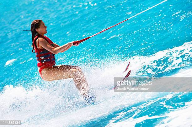 attractive young woman water skiing - waterskiing stock photos and pictures