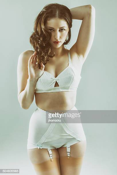 attractive young woman wearing vintage underwear - suspenders stock pictures, royalty-free photos & images