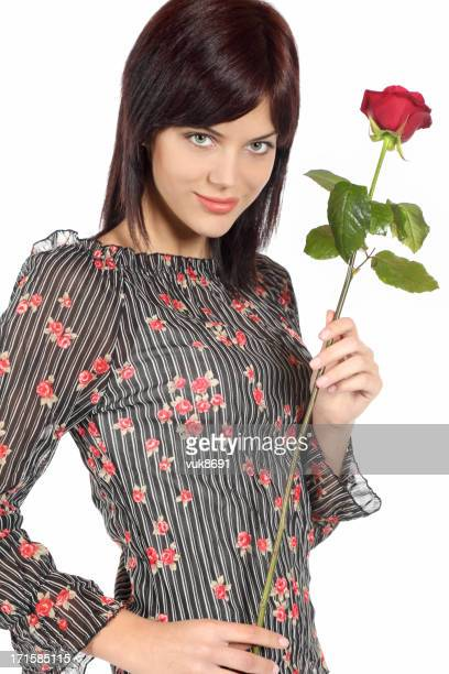attractive young woman with a red rose - individual event stock pictures, royalty-free photos & images