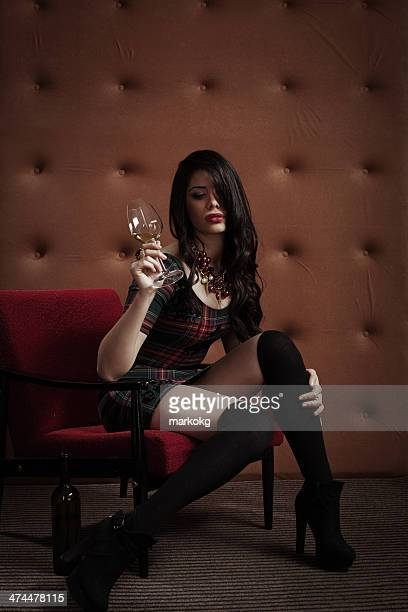 attractive young woman with glass of wine - mini dress stock photos and pictures