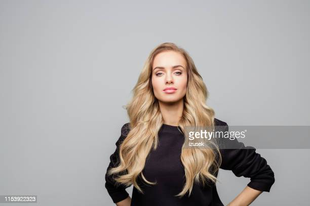 attractive young woman with long blond hair - long stock pictures, royalty-free photos & images