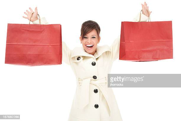 Attractive Young Woman with Red Shopping Bags