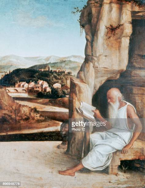 Attributed to Giovanni Bellini St Jerome in the Desert Jerome a father of Western Christian Church and compiler of the Vulgate reading Book Beard...