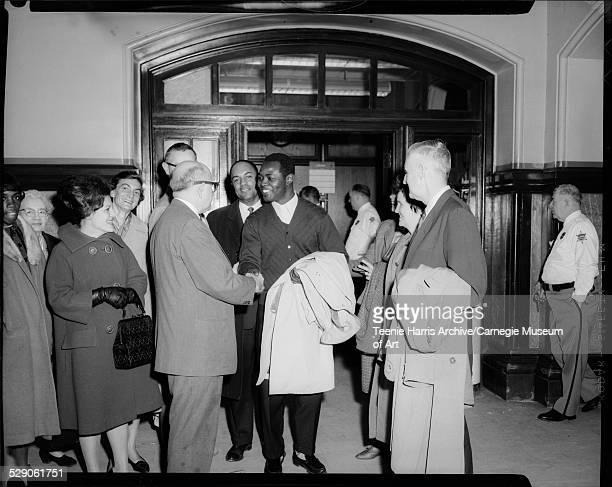 Atty Samuel Goldstock congratulating Zacheus Okediji after acquittal with from left Nadine Ratterman wearing dark gloves Florence Shute Dr Robert...