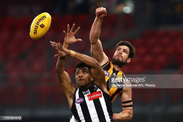 Atu Bosenavulagi of the Magpies and Ben Stratton of the Hawks contest the ball during the round 6 AFL match between the Collingwood Magpies and the...