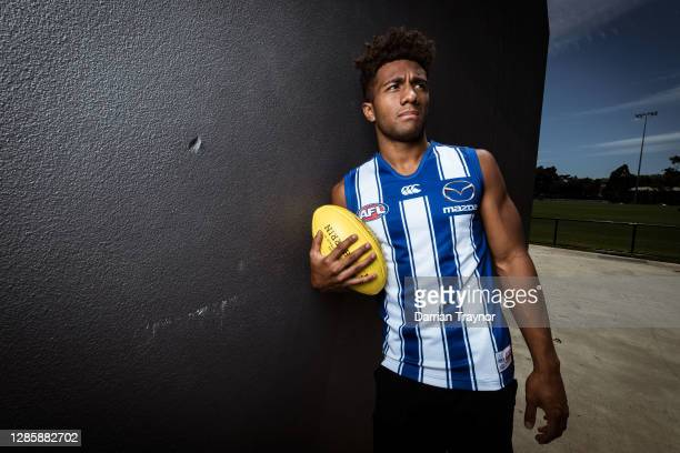 Atu Bosenavulagi poses for a photo during a North Melbourne Kangaroos AFL media opportunity at Arden Street Ground on November 16, 2020 in Melbourne,...