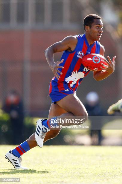 Atunaisa Bosenavualagi of the Chargers runs with the ball during the round 12 TAC Cup match between Oakleigh and Calder at Warrawee Park on July 14...