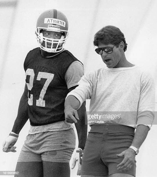 MAY 16 1989 JUL 16 1995 Atwater Steve Football Steve Atwater listens to advice from Coach Charlie Waters during Broncos practice inside the bubble