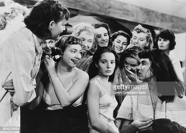 Au Royaume Des Cieux , movie still of girls in a dormatory, several girls appearing to taunt another girl, from the film noir movie by director...