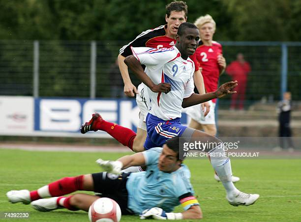 France's Abdoul Razak Boukari vies with Germany's goalkeeper Florian Fromlowitz during their under 21 international festival football match 04 june...