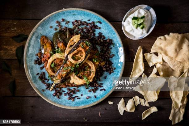aubergine curry with black rice and lentils - black rice stock pictures, royalty-free photos & images