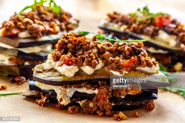 aubergine lasagne on baking paper, vegetarian - lasagna stock pictures, royalty-free photos & images