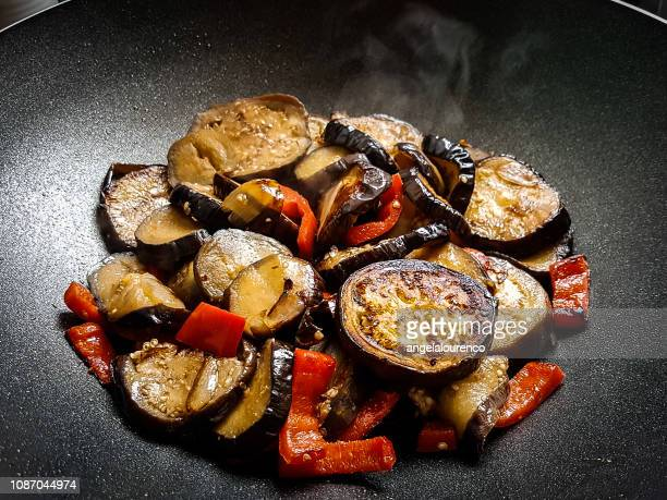 Aubergine, red pepper and onion stir-fry