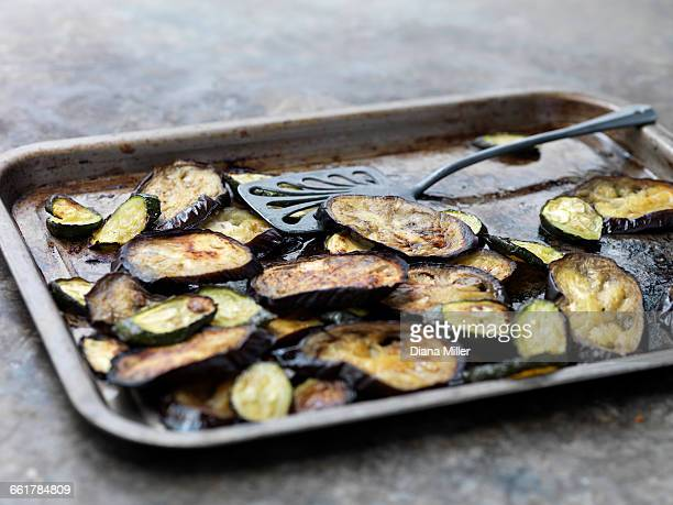 aubergine slices on baking tray - eggplant stock pictures, royalty-free photos & images