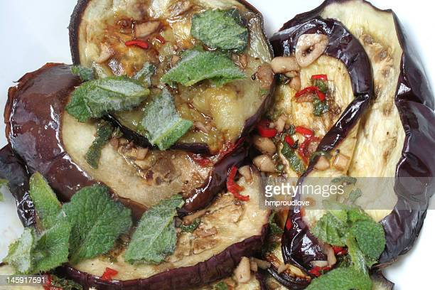 aubergine with mint - eggplant stock photos and pictures