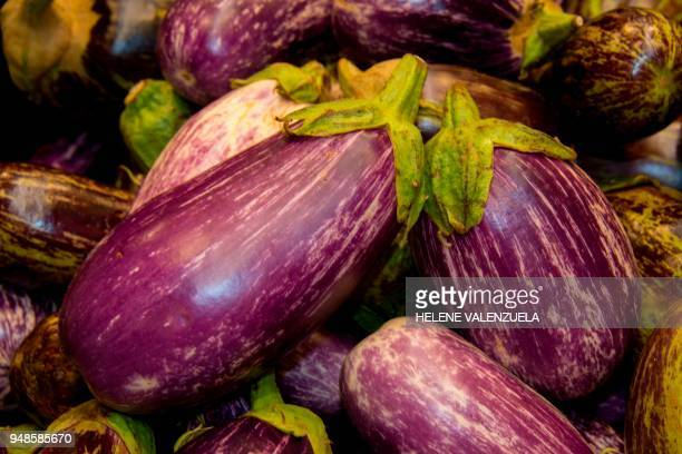 Aubergines are pictured at the fruit and vegetable department of an 'O Marche' supermarket in SaintFrancois on the French overseas territory of...