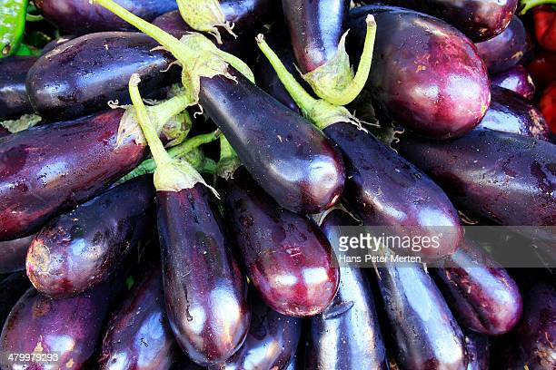 aubergines at market