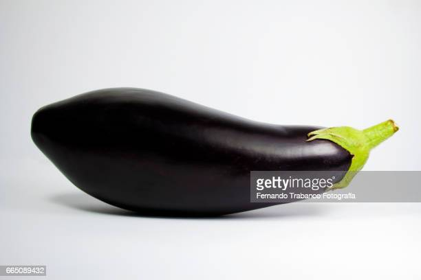 aubergines in a kitchen with white background