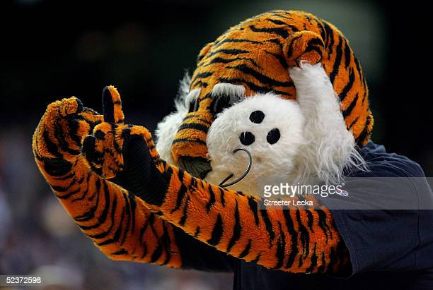 Aubie the mascot for the Auburn Tigers cheers during a time out in the first round of the SEC Men's Basketball Tournament against the Vanderbilt...
