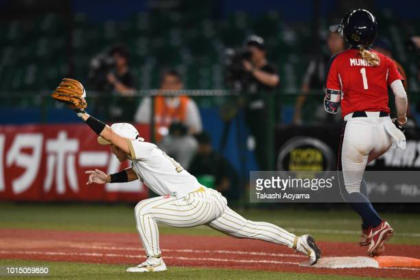 Aubree Aurielle Munro of United States is out at first base in the fourth inning against Japan during their Playoff Round match between United States...