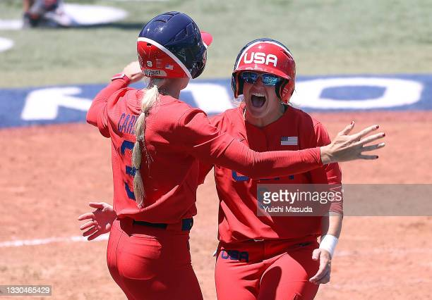 Aubree Munro and Haylie McCleney of Team United States celebrate after McCleney scored the first of the two runs in the eighth inning to win against...