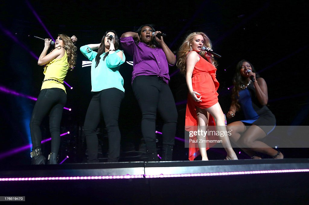 Aubrey Cleland, Angie Miller, Kree Harrison, Candice Glover, Janelle Arthur and Amber Holcomb perform during American Idol Live! 2013 at Prudential Center on August 14, 2013 in Newark, New Jersey.