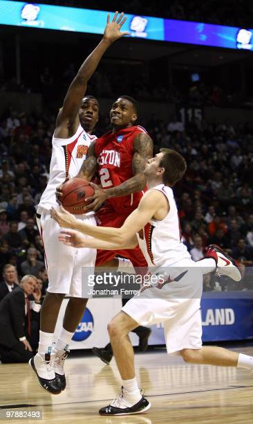 Aubrey Coleman of the Houston Cougars goes up for a shot against Eric Hayes and Dino Gregory of the Maryland Terrapins during the first round of the...