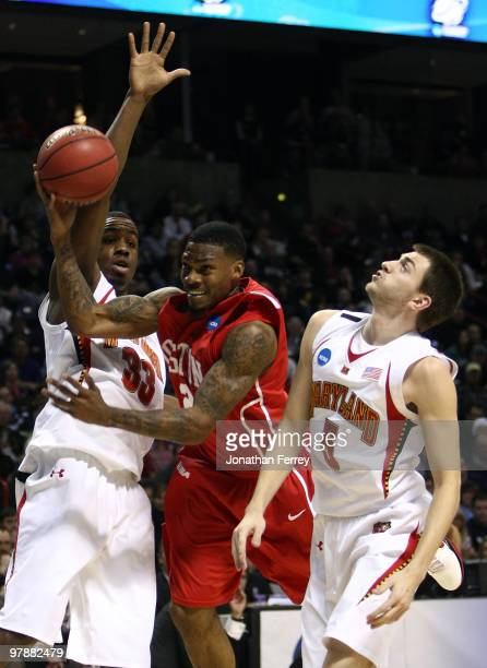 Aubrey Coleman of the Houston Cougars shoots the ball against Eric Hayes and Dino Gregory of the Maryland Terrapins during the first round of the...