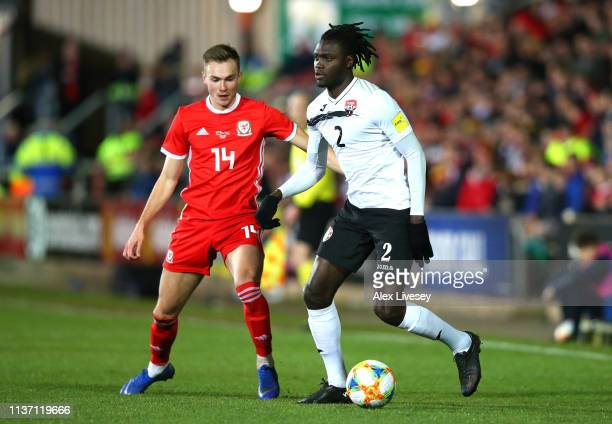Aubrey David of Trinidad and Tobago battles for possession with Ryan Hedges of Wales during the International Friendly match between Wales and...