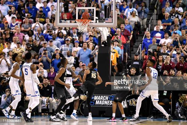 Aubrey Dawkins of the Central Florida Knights watches the ball following his lastsecond shot attempt against the Duke Blue Devils during the second...