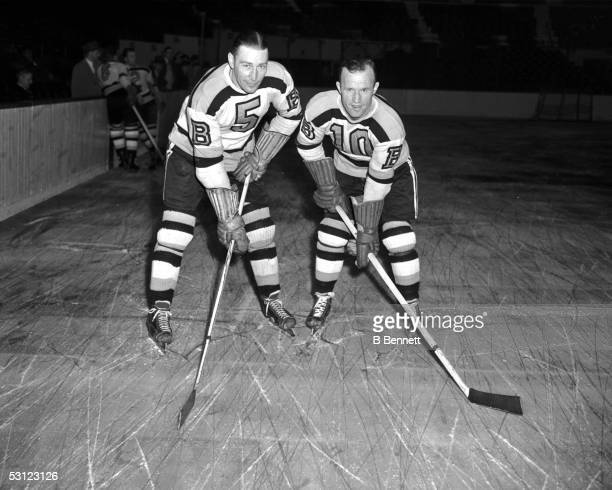 Aubrey 'Dit' Clapper and Bill Cowley of the Boston Bruins pose on the ice before an NHL game on October 23 1945