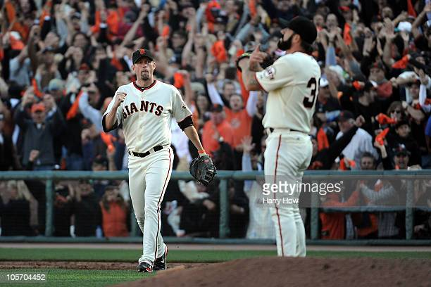 Aubrey Huff and Brian Wilson of the San Francisco Giants celebrate their win in Game Three of the NLCS against the Philadelphia Phillies during the...