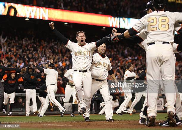 Aubrey Huff celebrates after Miguel Tejada of the San Francisco Giants hit the game winning hit in the ninth inning against the St Louis Cardinals at...