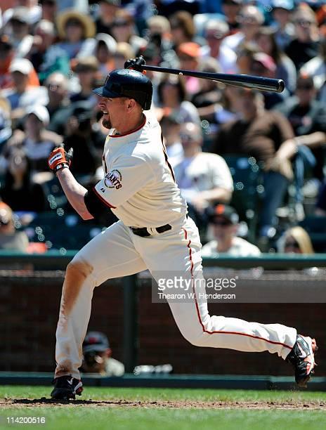 Aubrey Huff of the San Francisco Giants bats and puts the ball in play against the Arizona Diamondbacks during a MLB baseball game at ATT Park May 12...