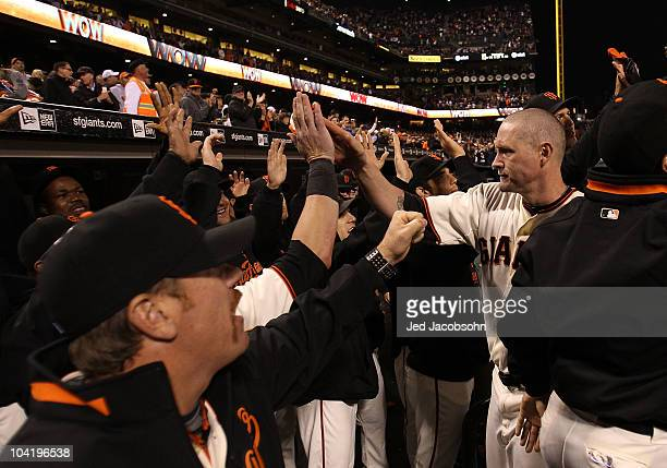 Aubrey Huff of the San Francisco Giants celebrates with teammates after hitting a three run home run against the Los Angeles Dodgers in the third...