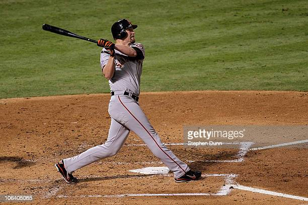 Aubrey Huff of the San Francisco Giants hits a 2run home run in the top of the third inning against the Texas Rangers in Game Four of the 2010 MLB...
