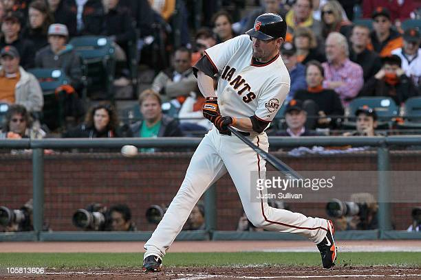 Aubrey Huff of the San Francisco Giants hits a single off Joe Blanton of the Philadelphia Phillies in the third inning of Game Four of the NLCS...