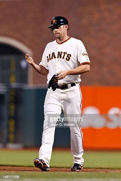 Aubrey Huff of the San Francisco Giants returns to the dugout after suffering an injury on a play at first base against the New York Mets during the...
